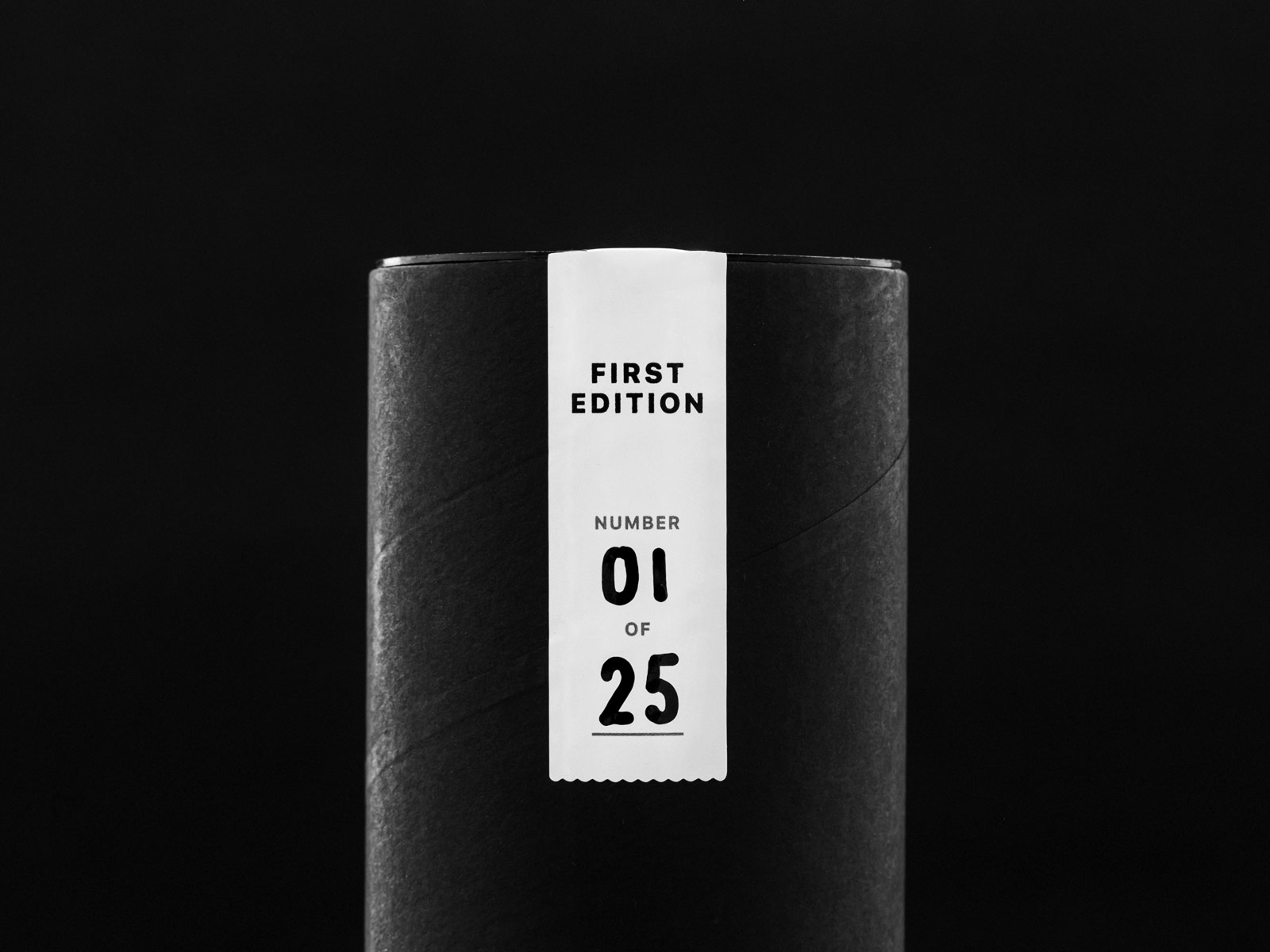 Close-up photo of the first edition seal on the black packaging tube